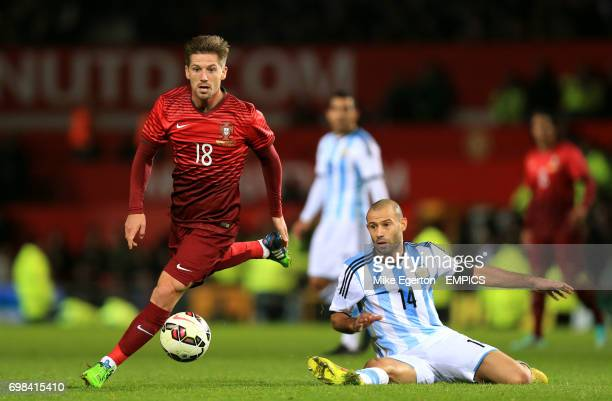 Portugal's Adrien Silva and Argentina's Javier Mascherano battle for the ball