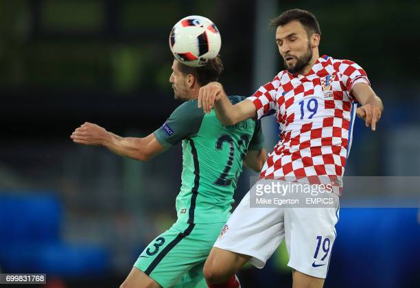 Portugal's Adrien Silva and Croatia's Milan Badelj battle for the ball