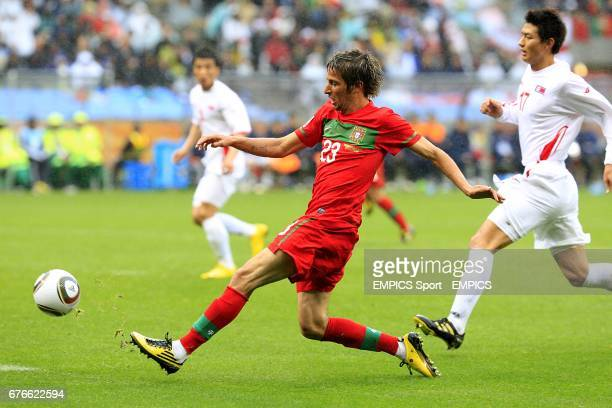 Portugal's Alexandre Fabio Coentrao gets a cross into the box