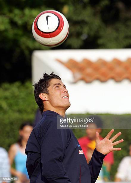Portugal's and Manchester United's striker Cristiano Ronaldo plays with the ball during a training session at the National stadium in Oeiras 10 km...