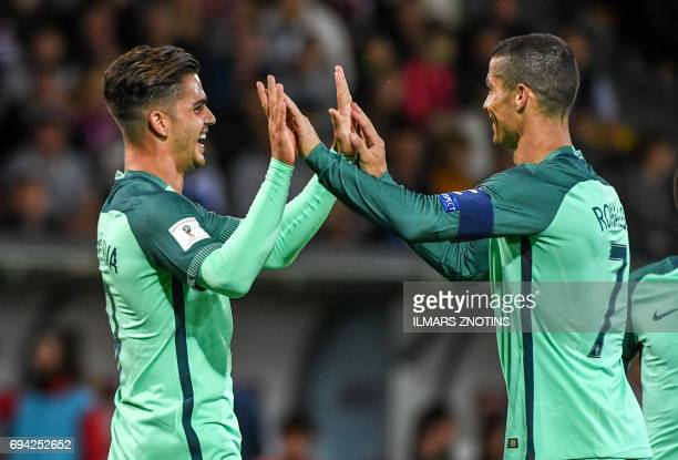Portugal's Andre Silva and Cristiano Ronaldo celebrate scoring during the FIFA World Cup 2018 qualification football match between Latvia and...
