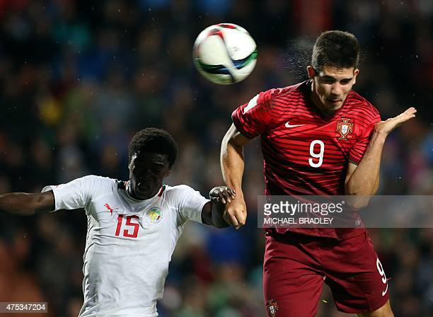 Portugal's Andre Silva hits a header to score a goal as Senegal's Moussa Wague tries to defend during the FIFA Under20 World Cup football match...