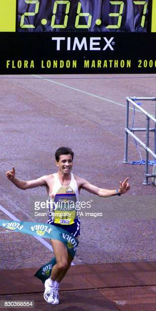 Portugal's Antonio Pinto celebrates after crossing the finishing line to win the men's 2000 London Marathon The athlete also smashed the European...