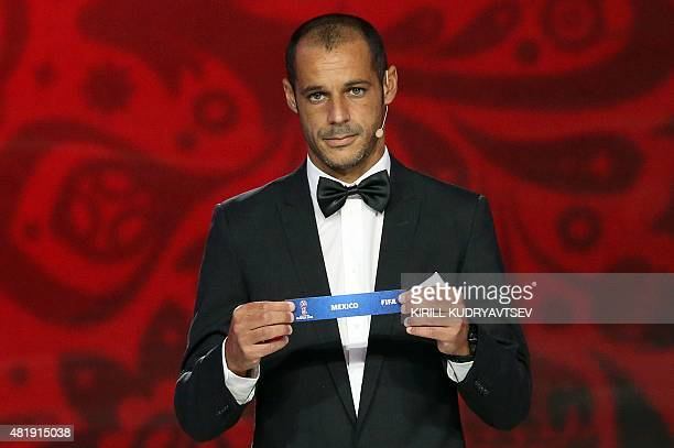 Portugal's beach soccer team forward and captain Madjer shows the name of Mexico during the preliminary draw for the Confederation of North Central...