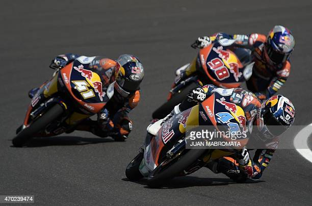 Portugal's biker Miguel Oliveira rides his KTM during the Moto3 qualifying to get the pole position next to teammates South Africa's biker Brad...