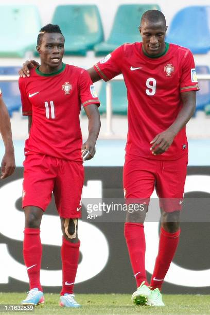 Portugal's Bruma celebrates with a teammate after scoring a goal during a group stage football match between Portugal and Cuba at the FIFA Under 20...