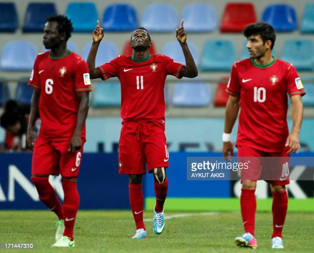 Portugal's Bruma celebrates with teammates after scoring during the group stage football match between Portugal and Republic of Korea at the FIFA...