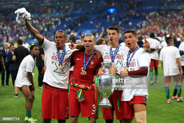 Portugal's Bruno Alves Pepe Jose Fonte and Cristiano Ronaldo celebrate with the The Henri Delaunay Cup after the game