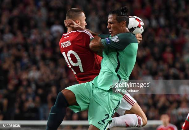 Portugal's Bruno Alves vies with Hungary's Tamas Priskin during the FIFA World Cup 2018 qualification football match between Hungary and Portugal in...