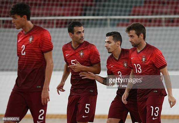 Portugal's Bruno Coelho celebrates with teammates after scoring a goal during the Futsal International Friendly match between Portugal and Morocco at...