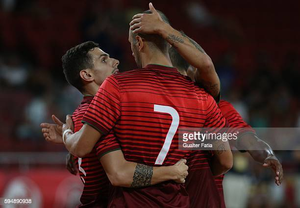 Portugal's Cardinal celebrates with teammates after scoring a goal in action during the Futsal International Friendly match between Portugal and...