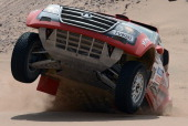 Portugal's Carlos Souza competes on his Great Wall during the Stage 12 of the Dakar 2013 between Fiambala Argentina and Copiapo Chile on January 17...