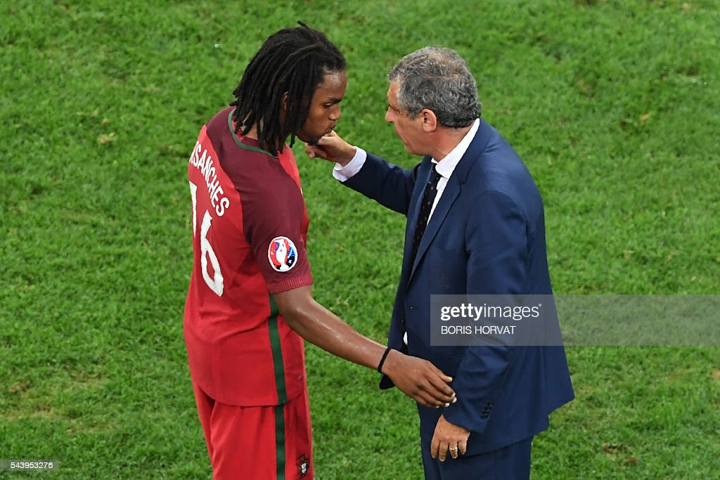 Portugal's coach Fernando Santos (R) conforts Portugal's midfielder Renato Sanches during the Euro 2016 quarter-final football match between Poland and Portugal at the Stade Velodrome in Marseille on June 30, 2016. / AFP / BORIS