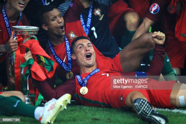 Portugal's Cristiano Ronaldo and his teammates celebrate with the The Henri Delaunay Cup after the game