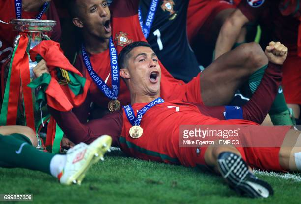Portugal's Cristiano Ronaldo and his teammates celebrate with the The Henri Delaunay Cup