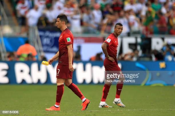 Portugal's Cristiano Ronaldo and Nani stand dejected
