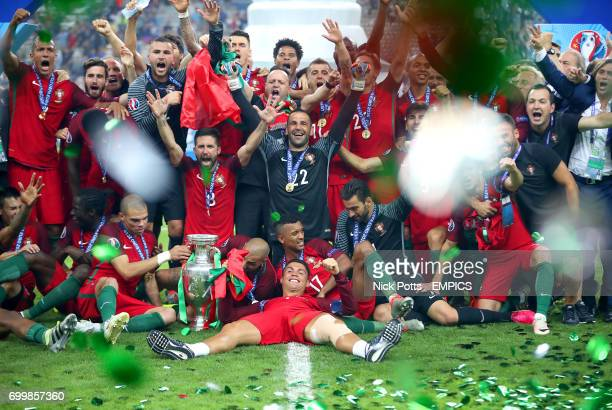 Portugal's Cristiano Ronaldo and teammates celebrate with the trophy on the pitch after winning the UEFA Euro 2016 final