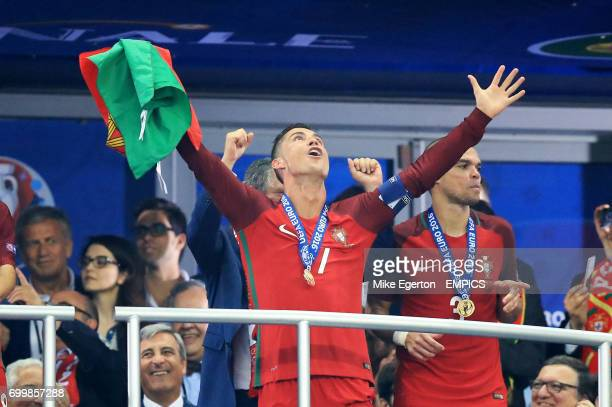 Portugal's Cristiano Ronaldo celebrates in the stands after the game