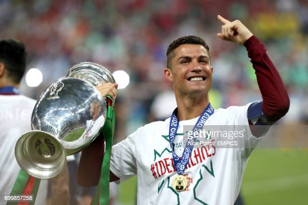 Portugal's Cristiano Ronaldo celebrates on the pitch with the trophy after Portugal win the UEFA Euro 2016 final