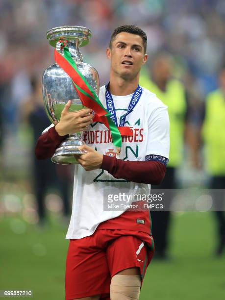 Portugal's Cristiano Ronaldo celebrates with the The Henri Delaunay Cup after the game