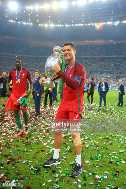 Portugal's Cristiano Ronaldo celebrates with the trophy on the pitch after Portugal win the UEFA Euro 2016 final