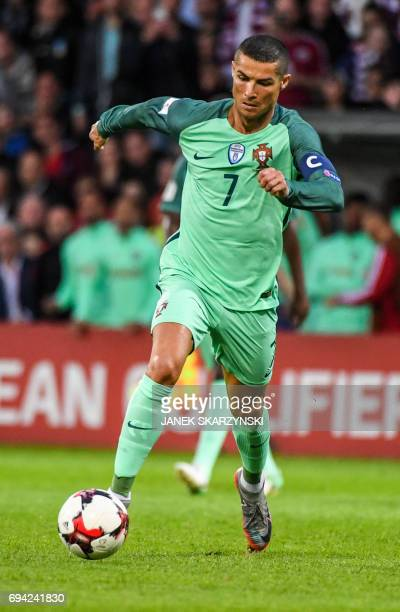 Portugal's Cristiano Ronaldo controls the ball during the FIFA World Cup 2018 qualification football match between Latvia and Portugal in Riga on...