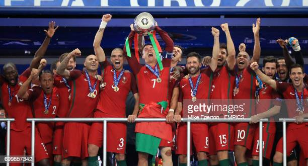 Portugal's Cristiano Ronaldo lifts The Henri Delaunay Cup with his teammates