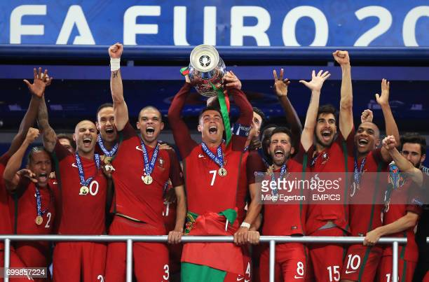 Portugal's Cristiano Ronaldo lifts the The Henri Delaunay Cup with his teammates