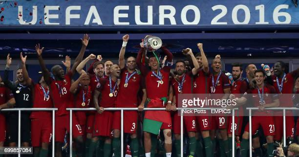 Portugal's Cristiano Ronaldo lifts the UEFA Euro 2016 trophy as Portugal are crowned the champions