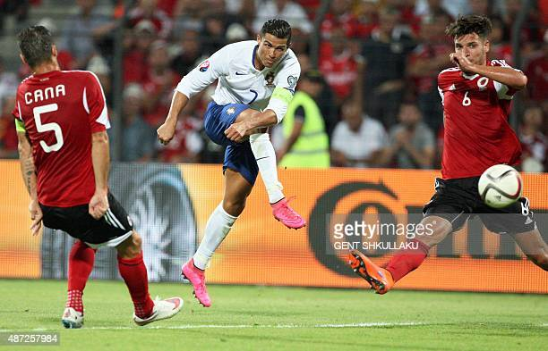 Portugal's Cristiano Ronaldo shoots the ball during the Euro 2016 qualifying football match between Albania and Portugal at the Elbasan Arena in...
