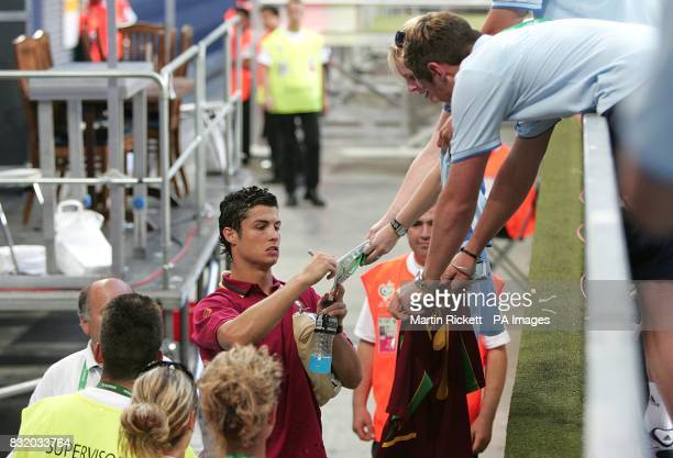 Portugal's Cristiano Ronaldo signs autographs as he leaves the stadium