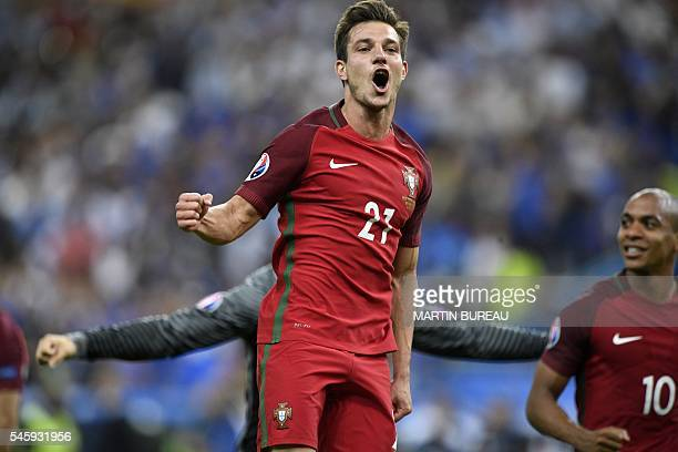 Portugal's defender Cedric Soares celebrates after Portugal beat their hosts France 10 in the Euro 2016 final football match between France and...