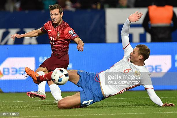 Portugal's defender Cedric vies for the ball with Russia's defender Aleksei Berezutski during the friendly football match between Russia and Portugal...