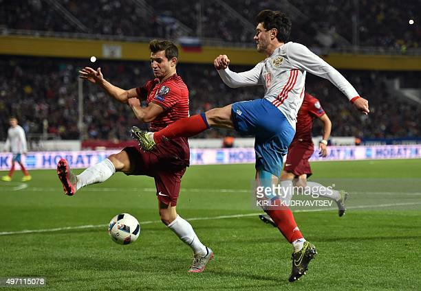 Portugal's defender Cedric vies for the ball with Russia's midfielder Yuri Zhirkov during the friendly football match between Russia and Portugal in...