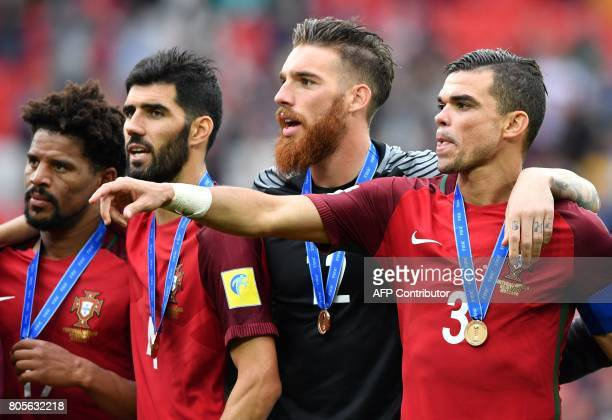 Portugal's defender Eliseu Portugal's defender Luis Neto Portugal's goalkeeper Jose Sa and Portugal's defender Pepe celebrate at the end of the 2017...