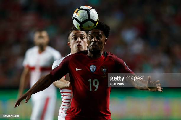 Portugal's defender Eliseu vies for the ball with Switzerland's midfielder Xherdan Shaqiri during the FIFA World Cup WC 2018 football qualifier match...