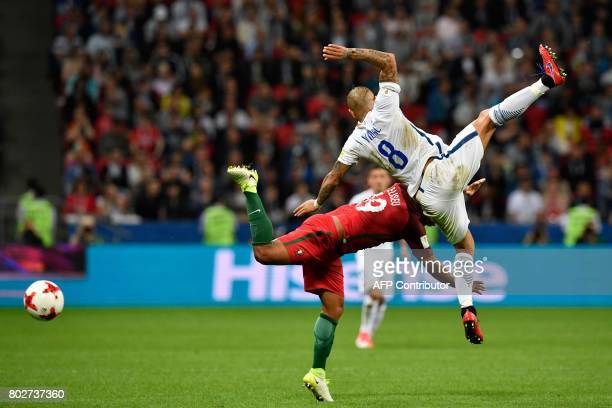 Portugal's defender Eliseu vies with Chile's midfielder Arturo Vidal during the 2017 Confederations Cup semifinal football match between Portugal and...