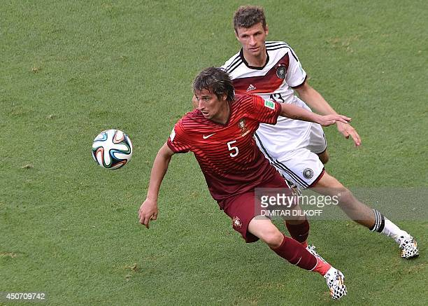 Portugal's defender Fabio Coentrao and Germany's forward Thomas Mueller vie during the Group G football match between Germany and Portugal at the...