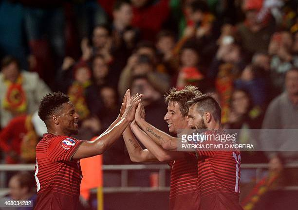 Portugal's defender Fabio Coentrao celebrates with teammates after scoring a goal during the Portugal vs Serbia EURO 2016 qualifying football match...