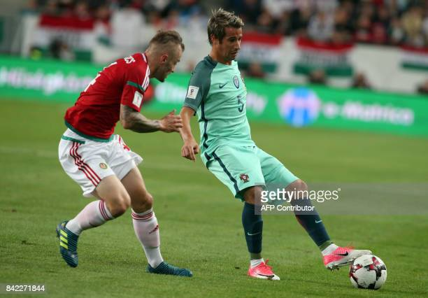Portugal's defender Fabio Coentrao vies for the ball with Hungary's Gergo Lovrencsics during the FIFA World Cup 2018 qualification football match...