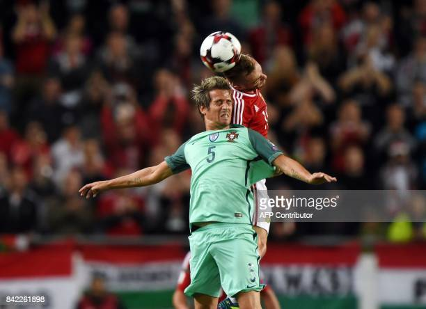Portugal's defender Fabio Coentrao vies with Hungary Gergo Lovrencsics during the FIFA World Cup 2018 qualification football match between Hungary...
