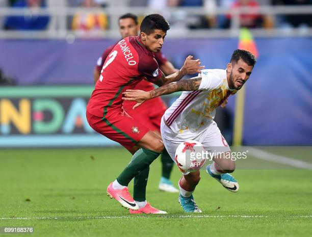 Portugal's defender Joao Cancelo and Spain's midfielder Daniel Ceballos Fernandez in action during the UEFA U21 European Championship Group B...