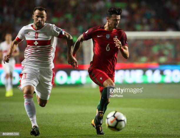 Portugal's defender Jose Fonte vies with Switzerland's forward Haris Seferovic during the FIFA 2018 World Cup Qualifier match between Portugal and...