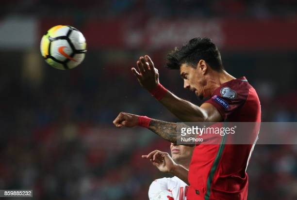 Portugal's defender Jose Fonte vies with Switzerland's midfielder Blerim Dzemaili during the FIFA 2018 World Cup Qualifier match between Portugal and...