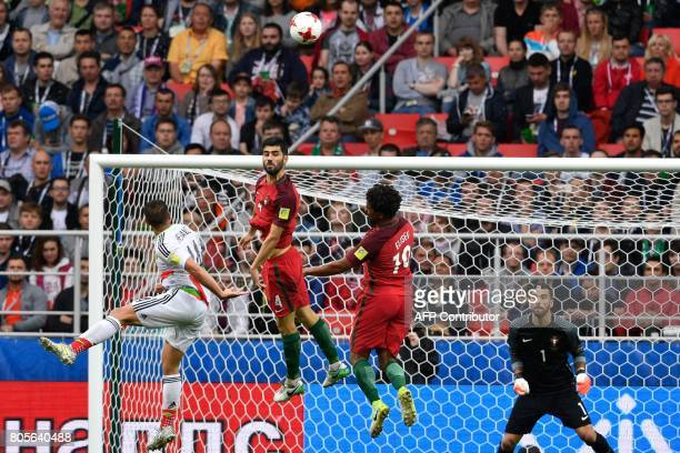 TOPSHOT Portugal's defender Luis Neto heads the ball during the 2017 Confederations Cup third place football match between Portugal and Mexico at...