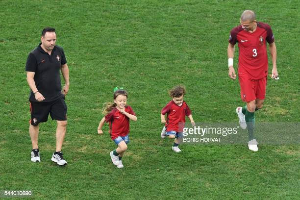 Portugal's defender Pepe and his daughters Angeli Sofia and Emily Maria run after the Euro 2016 quarterfinal football match between Poland and...
