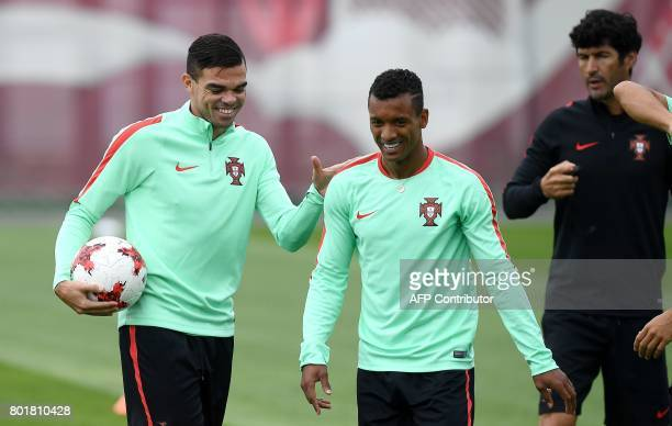 Portugal's defender Pepe and Portugal's forward Nani joke during a training session in Kazan Russia on June 27 2017 on the eve of the Russia 2017...