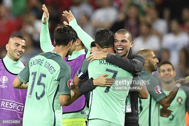 Portugal's defender Pepe hugs forward Cristiano Ronaldo after Portugal beat Wales 20 in the Euro 2016 semifinal football match between Portugal and...