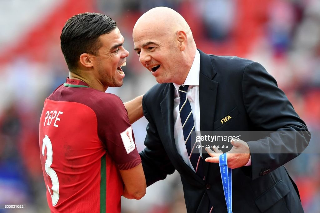 TOPSHOT - Portugal's defender Pepe is congratulated by FIFA president Gianni Infantino (R) before receiving his bronze medal at the end of the 2017 FIFA Confederations Cup third place football match between Portugal and Mexico at the Spartak Stadium in Moscow on July 2, 2017. / AFP PHOTO / Yuri KADOBNOV