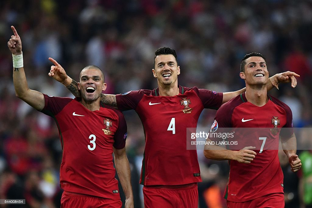 TOPSHOT - (From L) Portugal's defender Pepe, Portugal's defender Fonte and Portugal's forward Cristiano Ronaldo celebrate after winning the Euro 2016 quarter-final football match between Poland and Portugal at the Stade Velodrome in Marseille on June 30, 2016. / AFP / BERTRAND